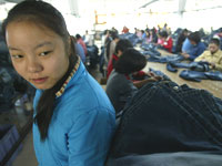 picture of a young girl working in a jeans factory